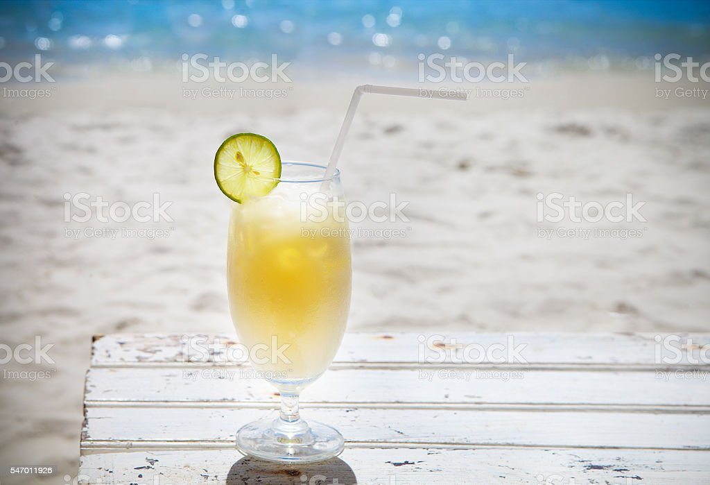 Tropical cocktail with rum on beautiful sunny beach stock photo