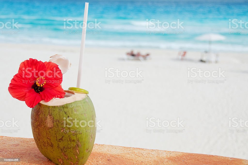 Tropical coconut cocktail on beach royalty-free stock photo