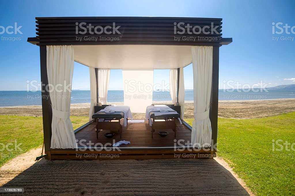 Tropical day spa beds on the beach royalty-free stock photo