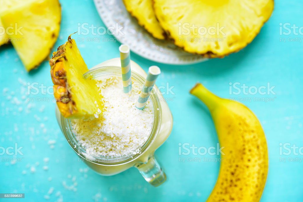 Tropical diet smoothie in a mason jar. stock photo