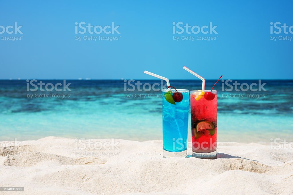 Tropical drink at sunny beach stock photo