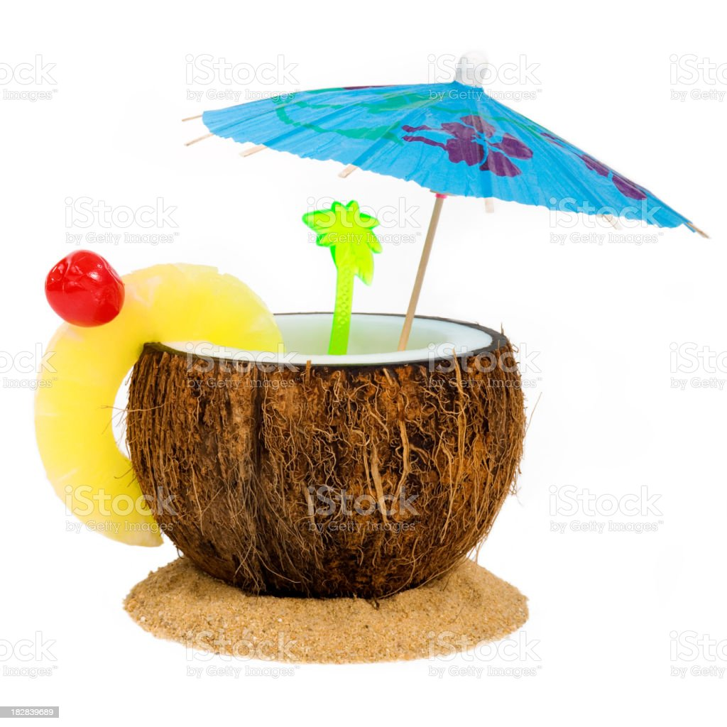 Tropical drink in a coconut with umbrella on white background stock photo
