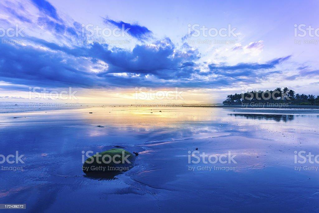 Tropical Empty Beach at Sunrise in Bali, Indonesia stock photo