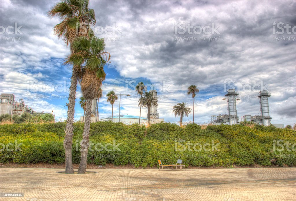 tropical factory at dramatic sky background blurred hdr stock photo