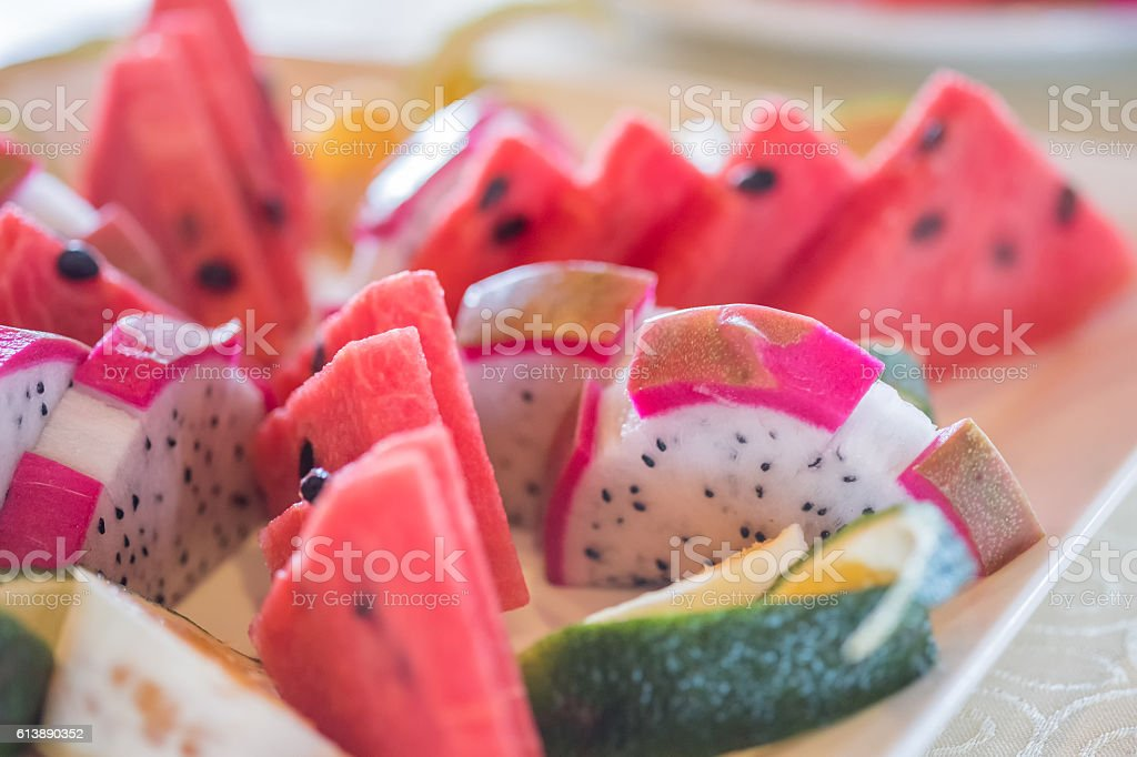 Tropical Fruit Platter of Cut Watermelon, Dragon Fruit and Oranges stock photo