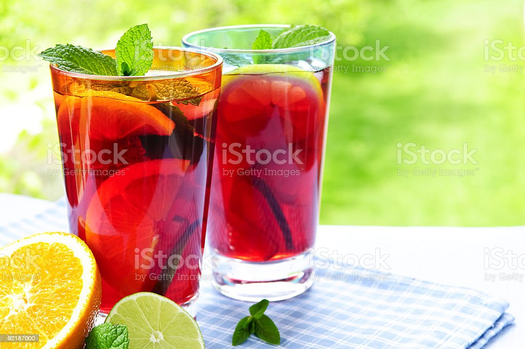 Tropical fruit punch in two glasses with lemons inside royalty-free stock photo