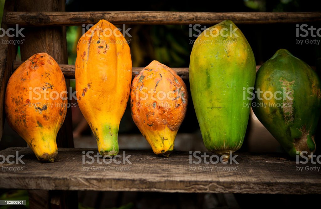 tropical fruits in a fruit stand stock photo