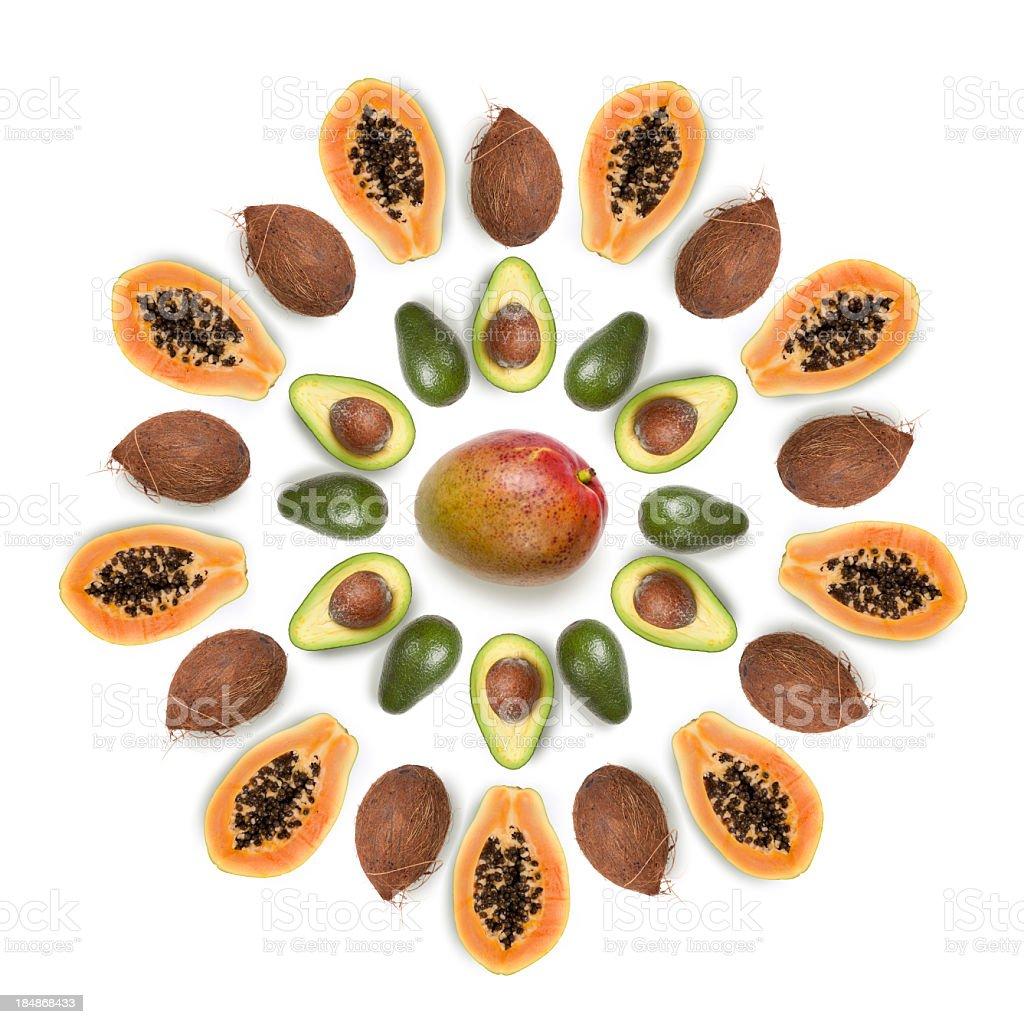 Tropical fruits in sun shaped composition: mango, coconut, avocado, papaya royalty-free stock photo