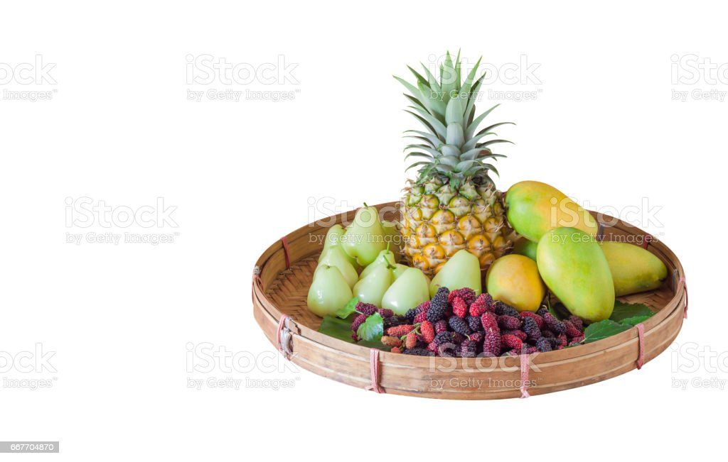 tropical fruits in threshing basket on white background stock photo