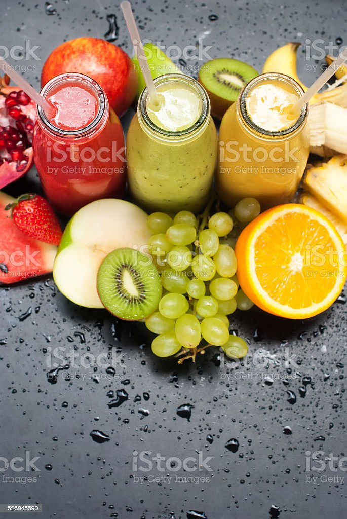Tropical Fruits Juices Smoothie Red Green Yellow stock photo
