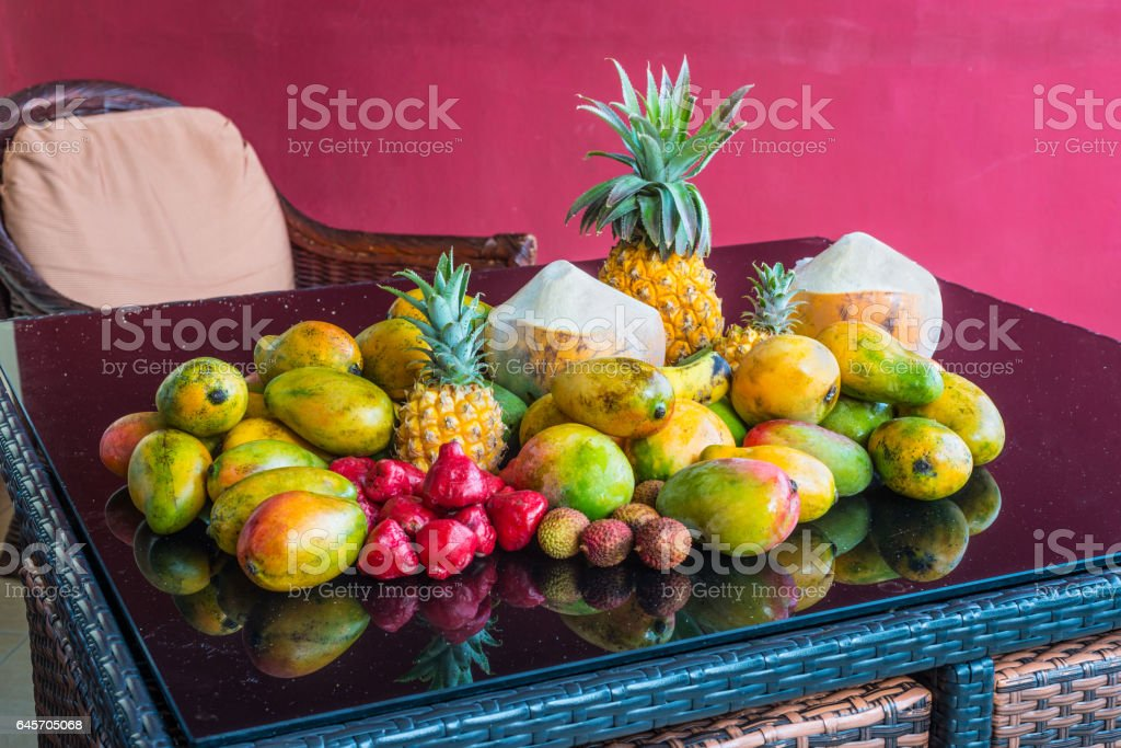 Tropical fruits on the table with reflection stock photo