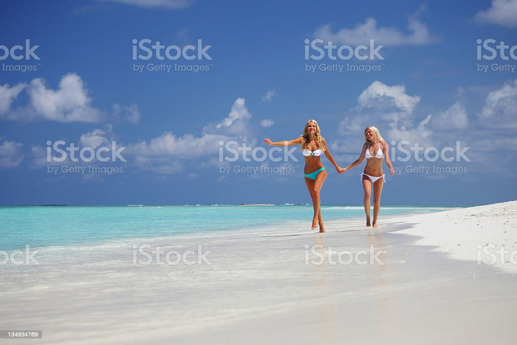 tropical girls run royalty-free stock photo