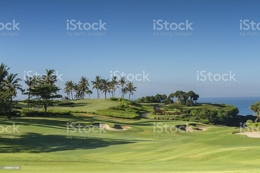 Tropical golf course by the sea in Asia stock photo