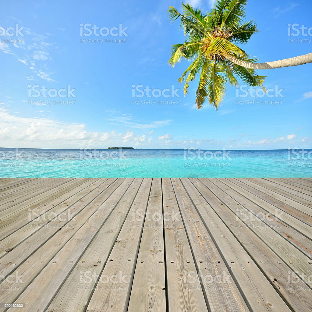 Tropical green lagoon and empty wooden pier stock photo