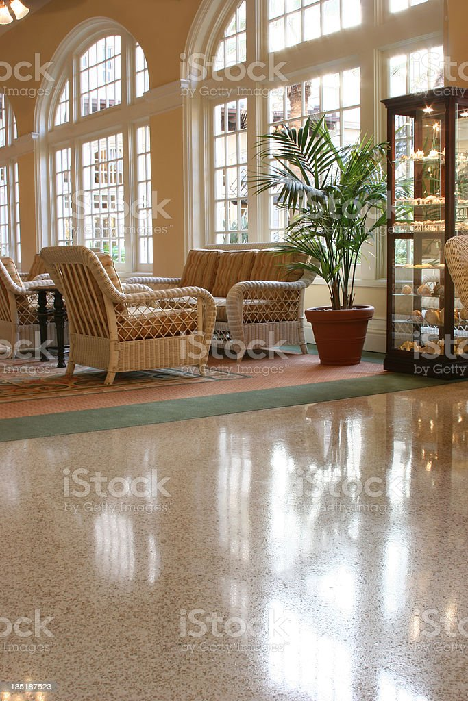 Tropical hotel lobby. Wicker seating area, windows. Beach front property. royalty-free stock photo