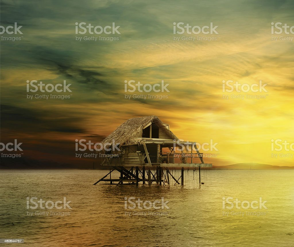 Tropical house on water stock photo