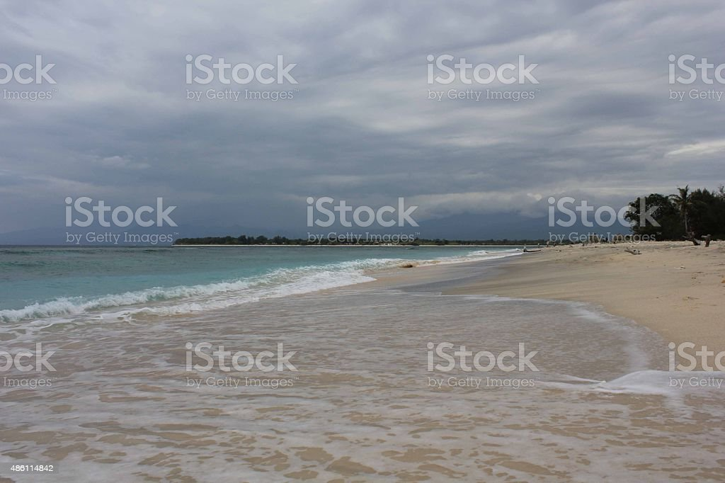 Tropical Indonesian Gili Islands beach water's edge stock photo