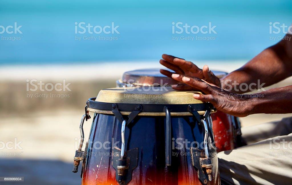 Tropical Island Conga Player closeup stock photo