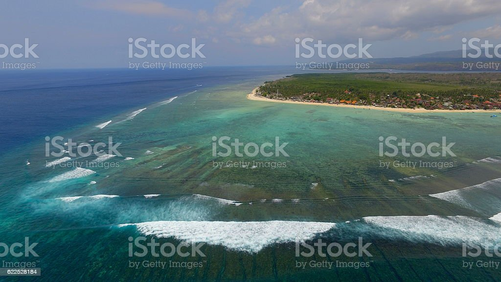 Tropical island, coral reef and surf stock photo