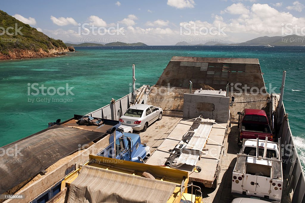 tropical island ferry boat arriving stock photo