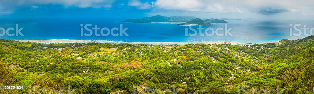 Tropical island green jungle overlooking blue Indian Ocean panorama Seychelles stock photo