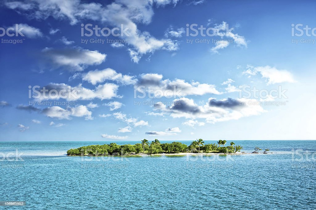 Tropical island in the clear blue ocean stock photo
