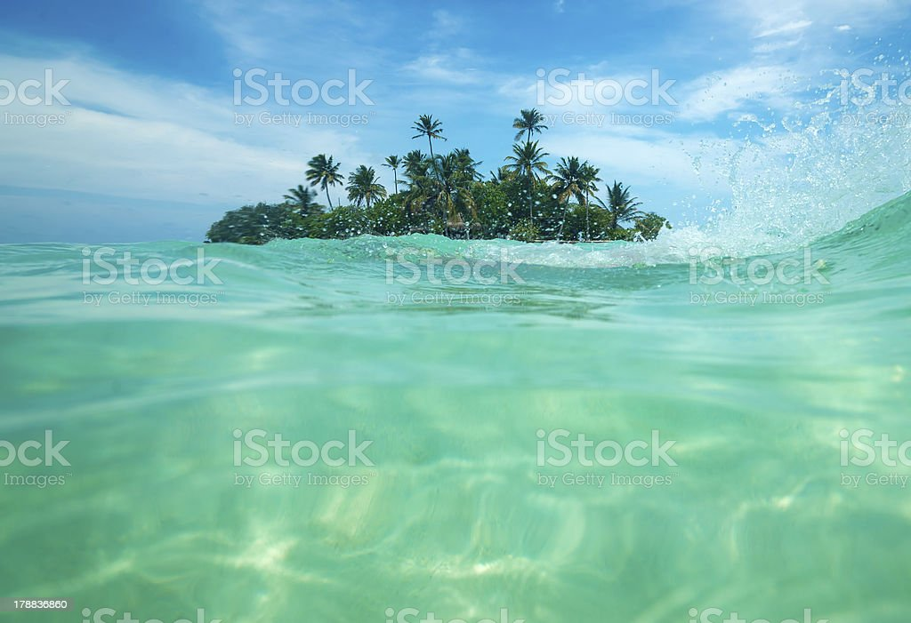 Tropical island in the ocean royalty-free stock photo