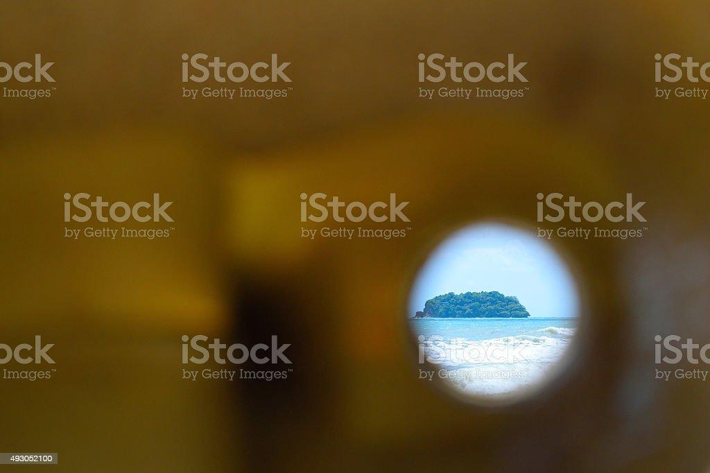 Tropical Island Spy Hole stock photo