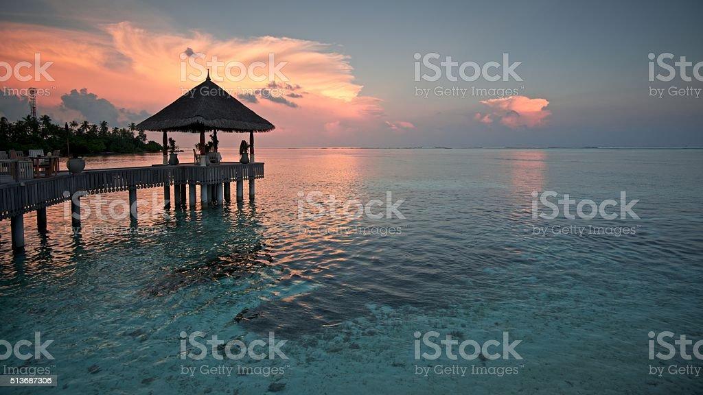 Tropical Island Sunset at Maldives stock photo