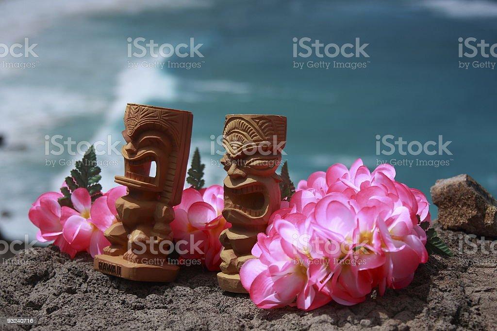 Tropical island tiki hawaii oahu waikiki honolulu polynesia ocean lei royalty-free stock photo