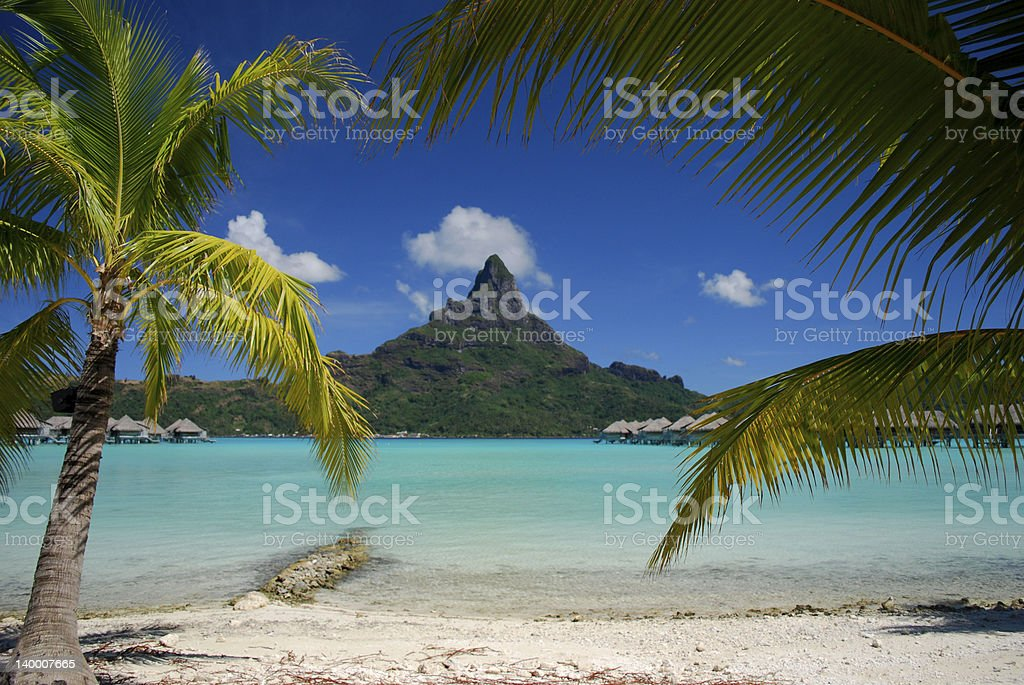 Tropical island with mountain horizon stock photo