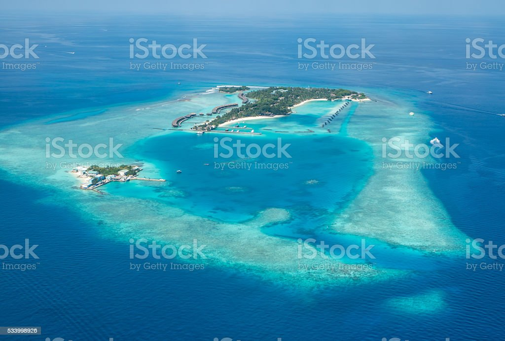 Tropical islands and atolls in Maldives from aerial view stock photo