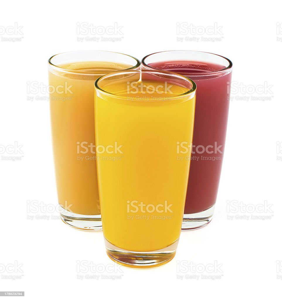 Tropical juices in glasses isolated on white royalty-free stock photo