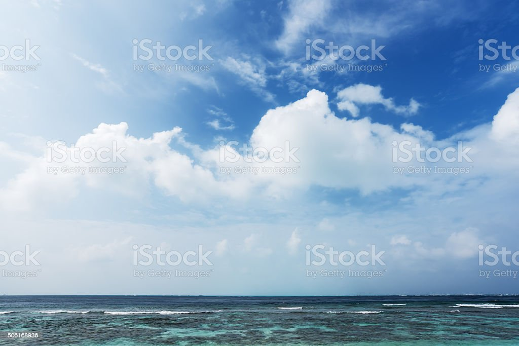 Tropical lagoon and blue sky background stock photo