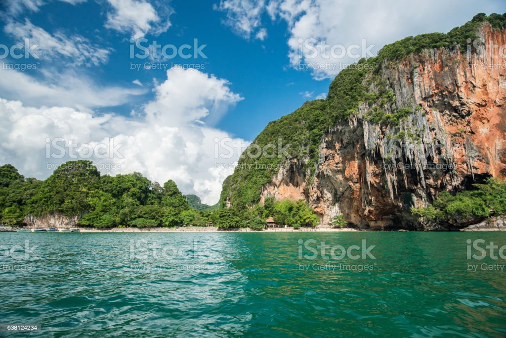 Tropical landscape with rock islands, lonely boat and crystal cl stock photo