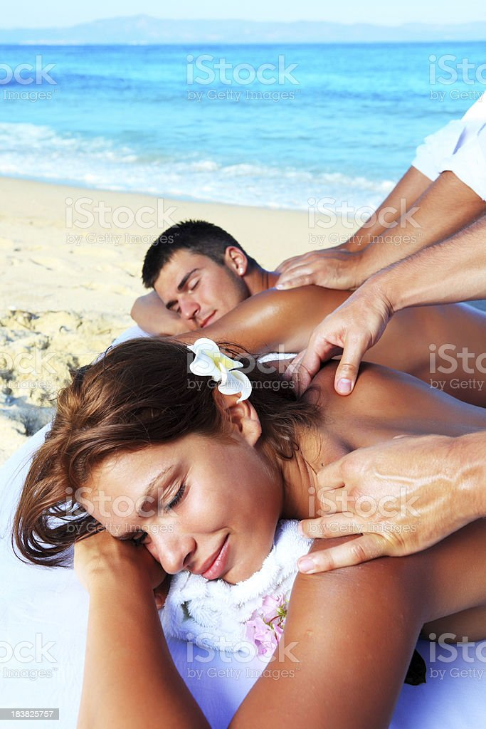 Tropical massage on the beach. royalty-free stock photo