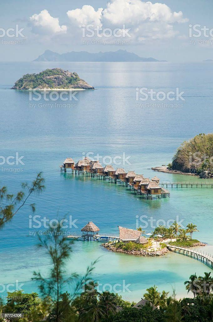 Tropical ocean resort with huts in the water stock photo
