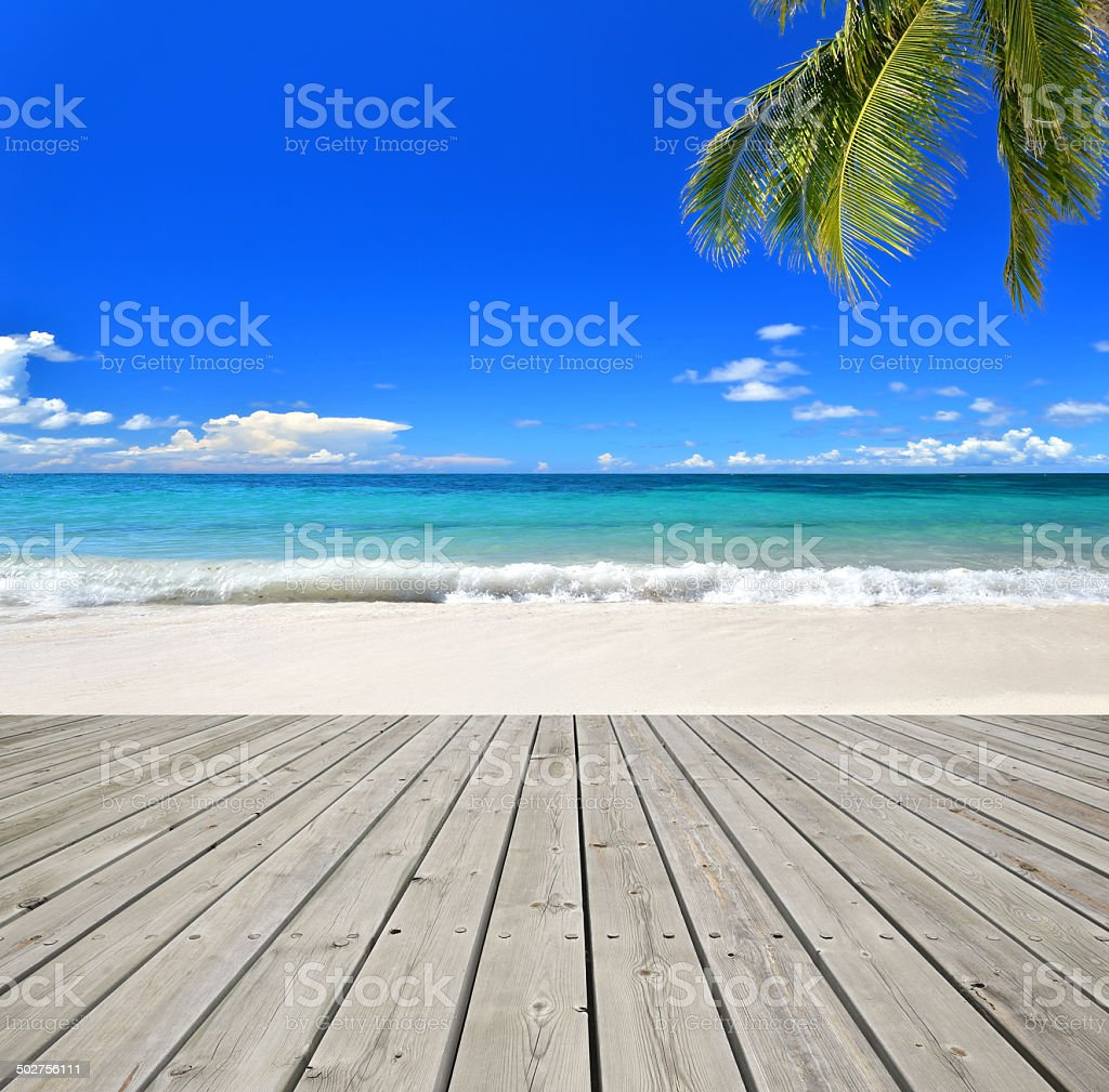 Tropical paradise beach with wooden platform stock photo