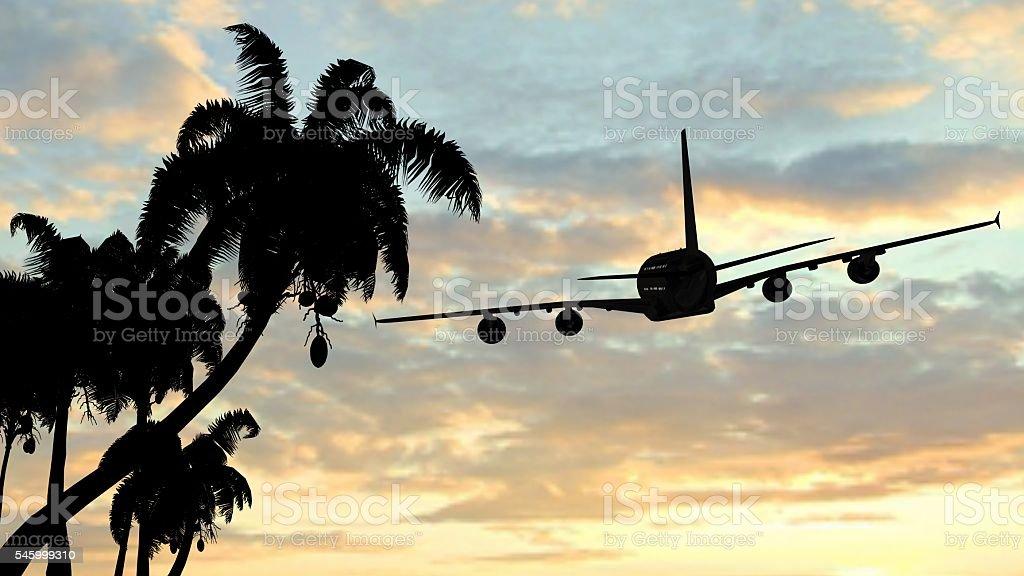 Tropical paradise holiday - Airplane flying over amazing sunset stock photo
