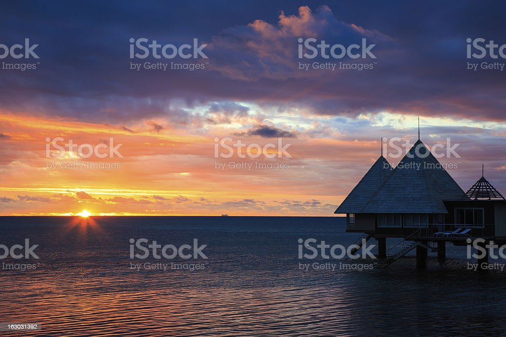 Tropical Paradise Luxury Over Water Resort at Sunset stock photo
