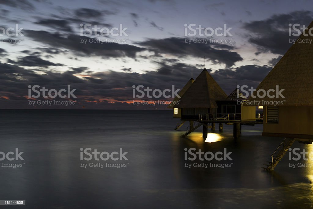 Tropical Paradise Luxury Over Water Resort at Sunset royalty-free stock photo