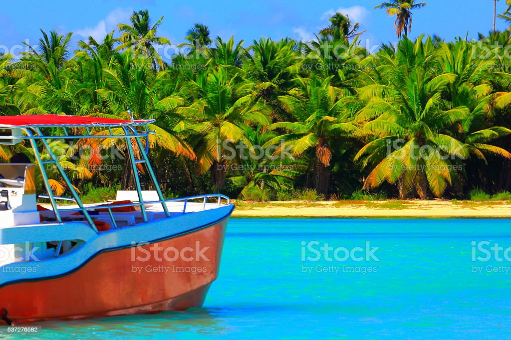Tropical paradise relax: turquoise caribbean beach, ship, palm trees woods stock photo