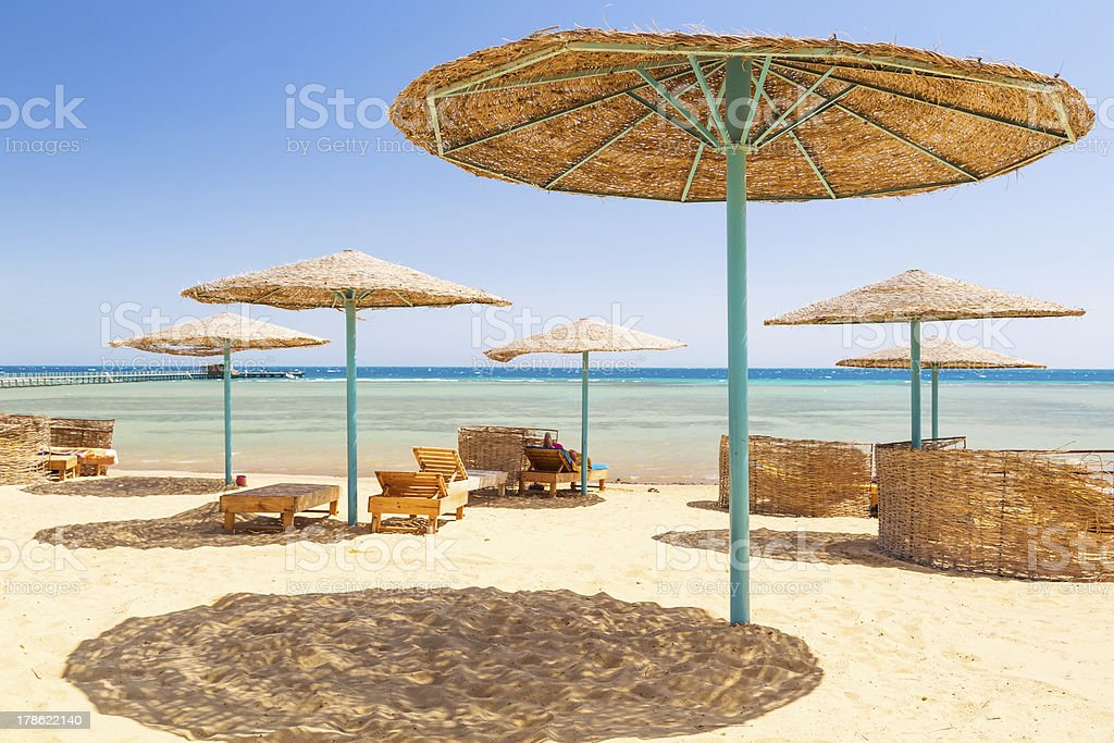 Tropical parasol on the beach of Red Sea stock photo