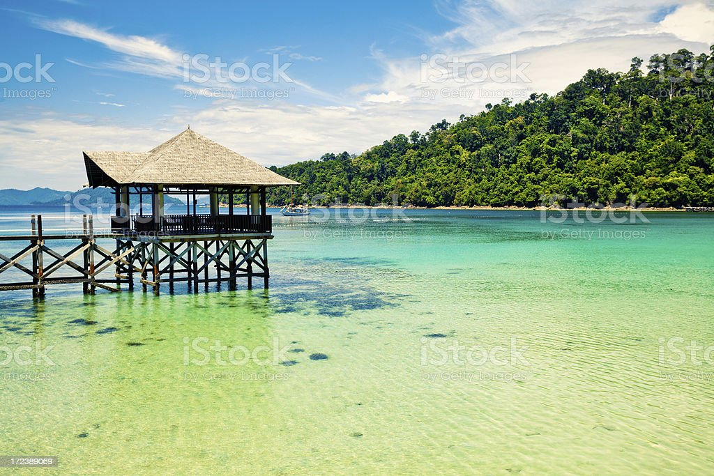 Tropical Pier and Jungle Island royalty-free stock photo