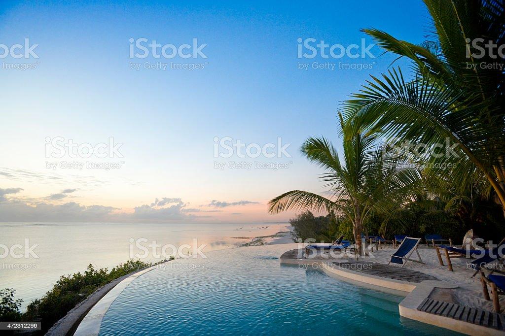 Tropical pool resort overlooking the Indian Ocean stock photo