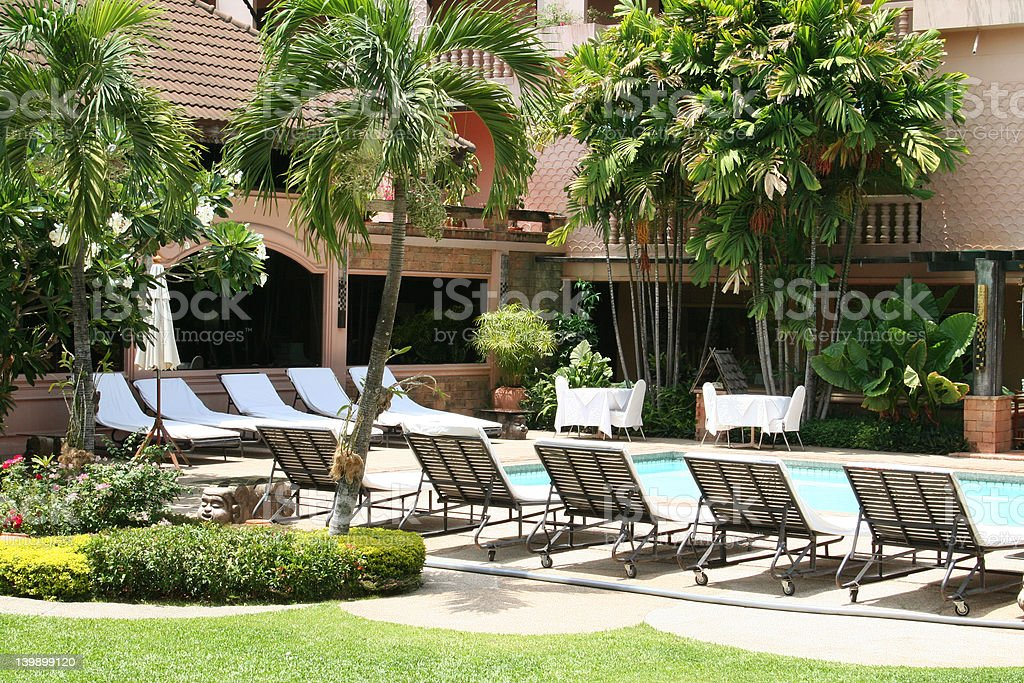 Tropical poolside royalty-free stock photo