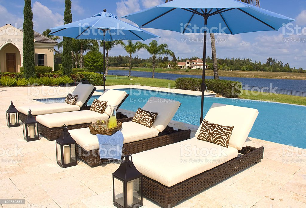 Tropical Poolside Recliners And Umbrellas royalty-free stock photo