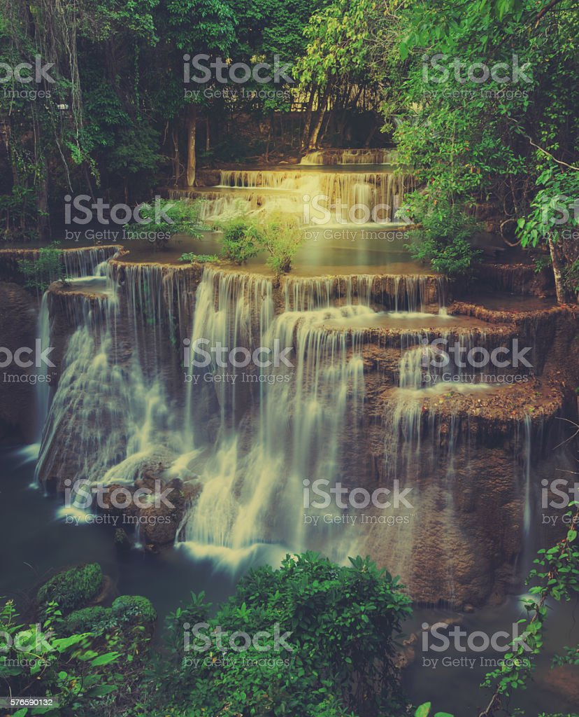 Tropical rainforest waterfall in Thailand. Retro filtered color stock photo