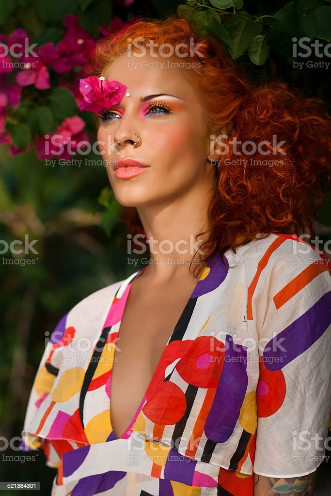 Tropical redhaired model stock photo