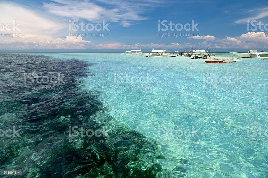 Tropischen Riff und Boote Lizenzfreies stock-foto